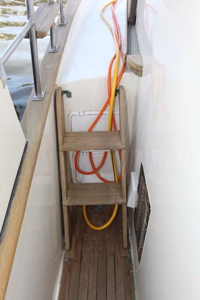 Port Sidedeck Shorepower And Water Connection Under Companionway Stairs