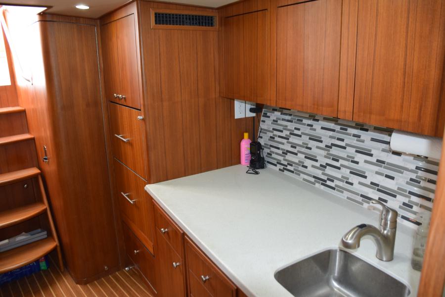 Corian countertops and glass tile backsplash