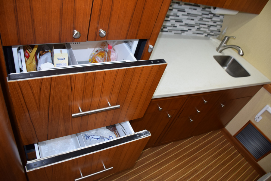 Refrigerator and freezer drawers with icemaker