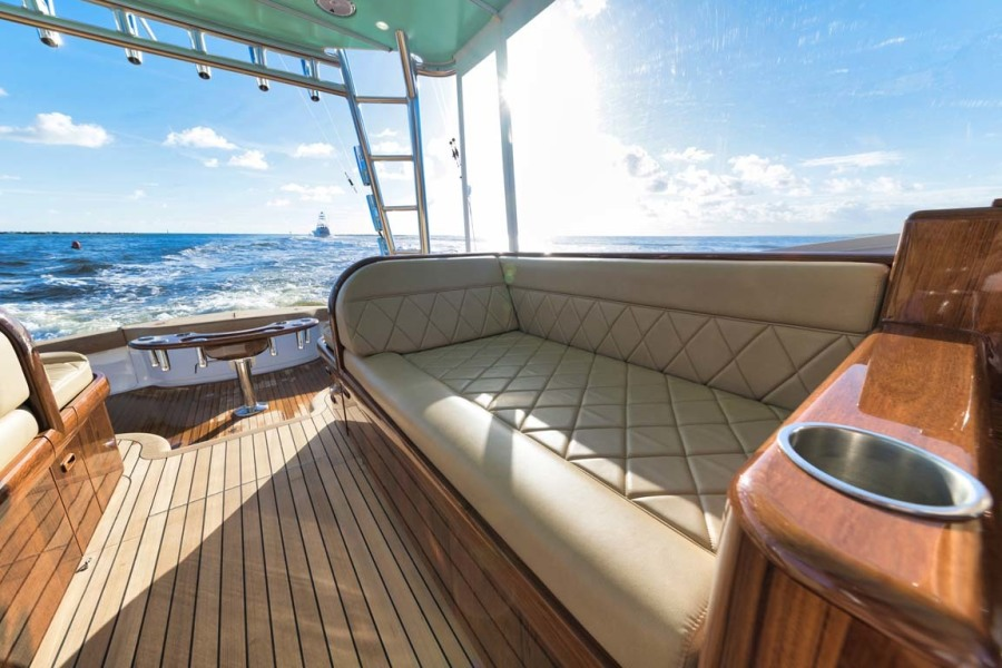 Teak Port Seating with Diamond Stitched Ultra-Leather Upholstery and Storage Below