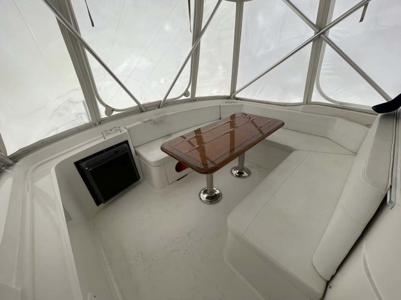 Massive U-Shaped Seating Area Forward of the Helm Station with Storage Beneath