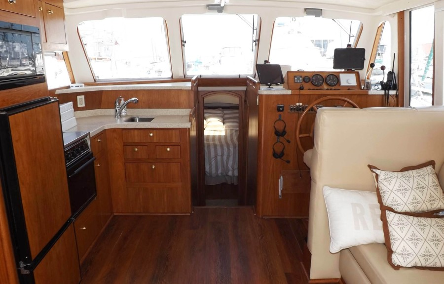 Galley To Port, Salon And Lower Helm To Starboard