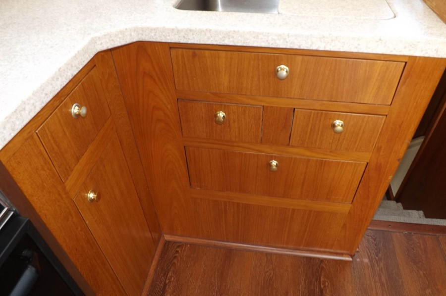 Teak Cabinetry With Excellent Door And Drawer Galley Storage
