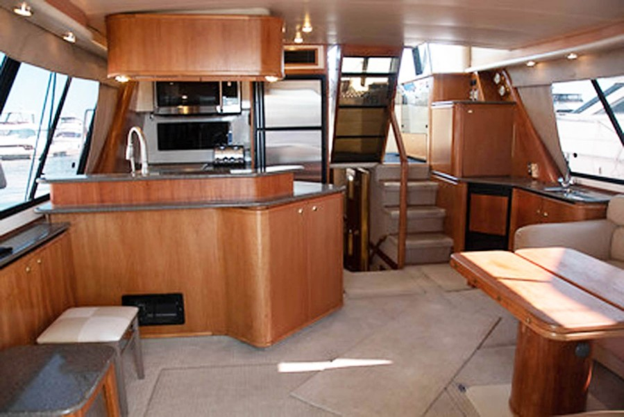 Galley to Port and Salon Wet Bar to Starboard