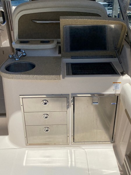 Cockpit sink, grill, and refrigerator