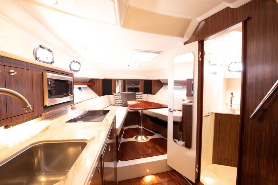 Galley to Port, Convertible Dinette Forward and Head to Starboard