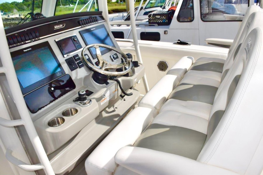 Helm console and folding bolster seats