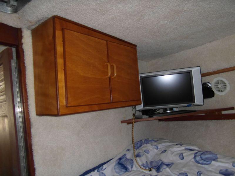 1995 Sportfish Main Cabin Storage and TV