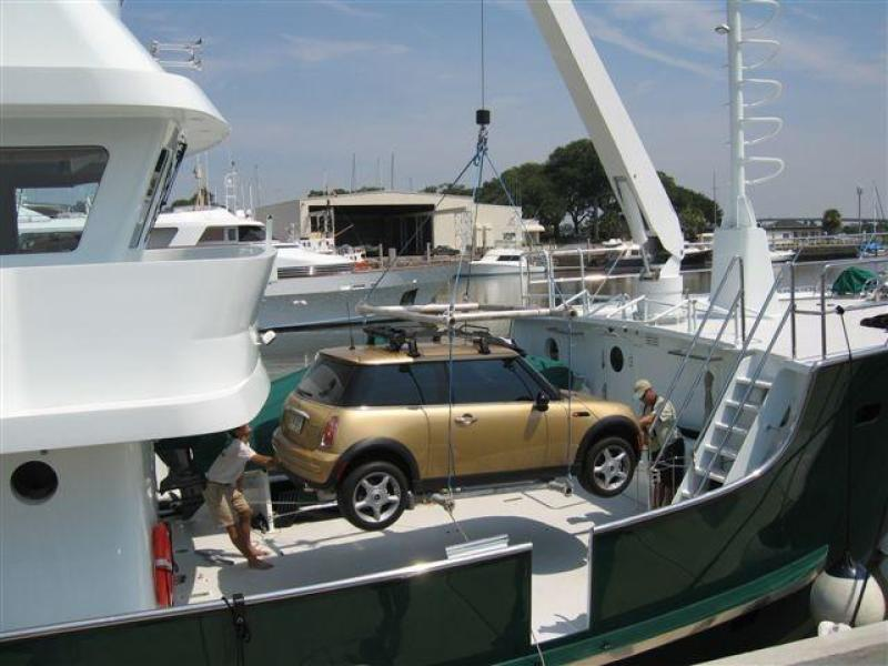 Mini Cooper being lifted on board