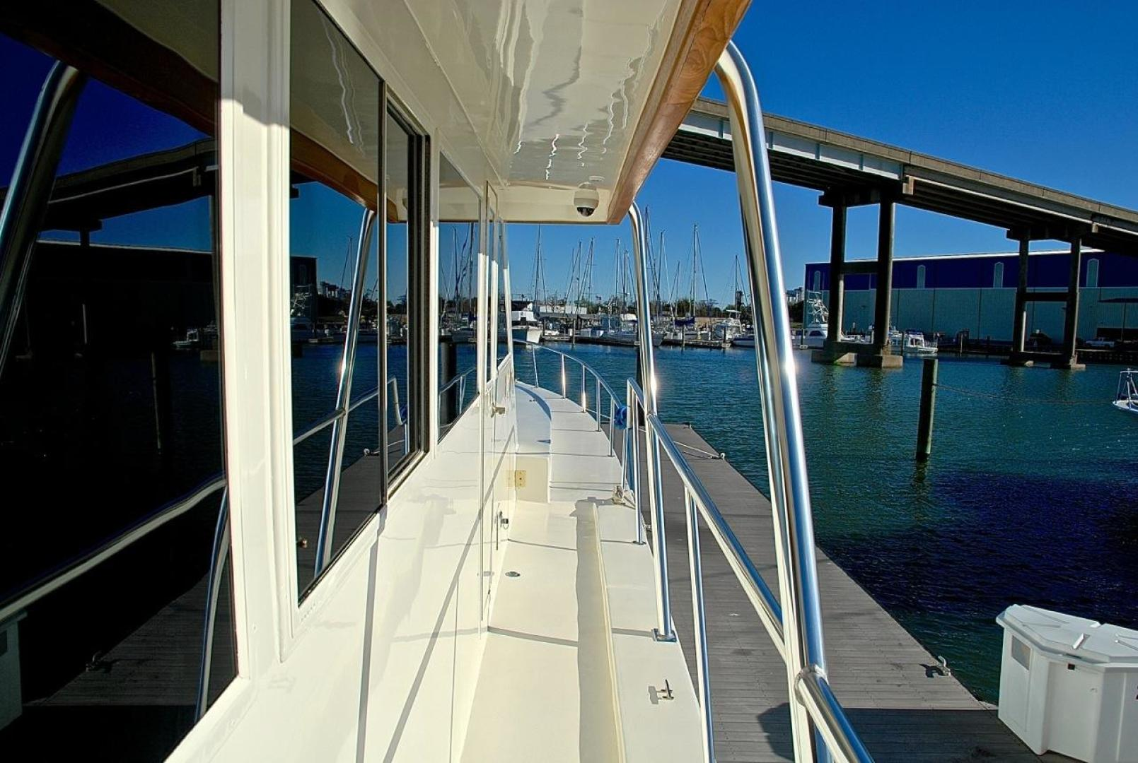 Infinity-Cockpit Motor Yacht 2001-Dont Matter Houston-Texas-United States-Side Deck Forward View-1005577 | Thumbnail