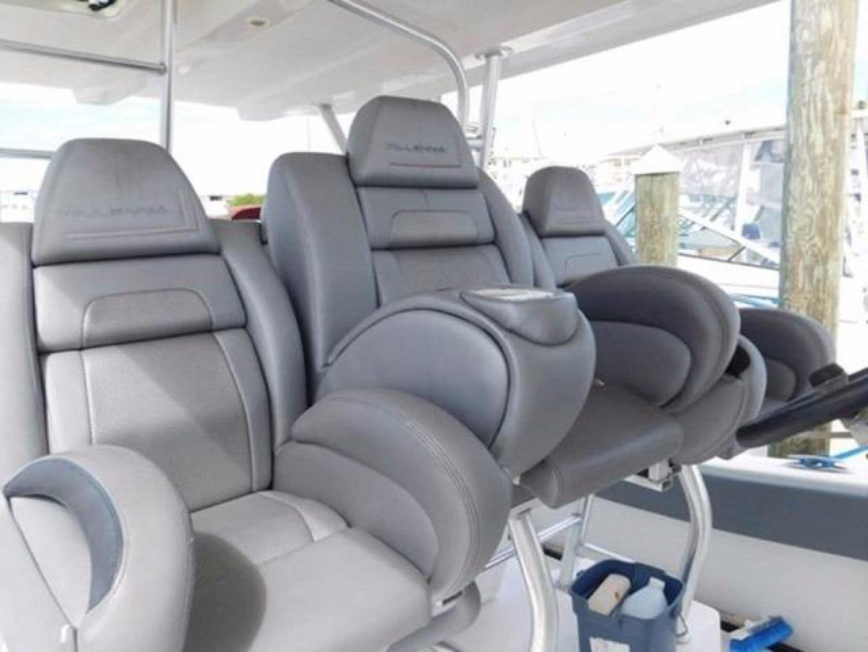 Millennia-Catamaran Center Console S/F 2009 -Madeira Beach-Florida-United States-Helm Seating-925389 | Thumbnail