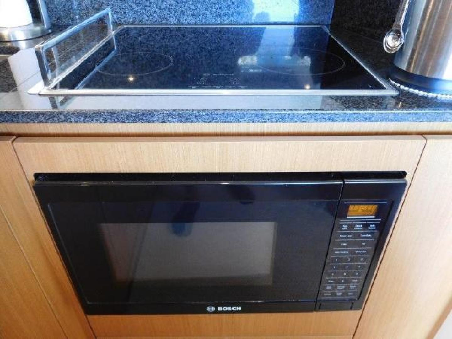 Ferretti Yachts-630 2009-BREAKAWAY Treasure Island-Florida-United States-Galley  Bosch Cooktop and Microwave-1097543 | Thumbnail
