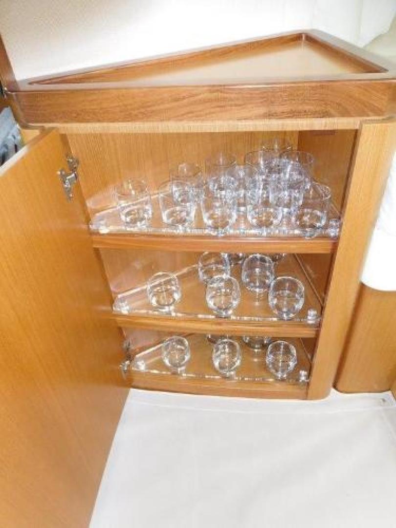 Ferretti Yachts-630 2009-BREAKAWAY Treasure Island-Florida-United States-Cabinet with Glass Storage-1097534 | Thumbnail