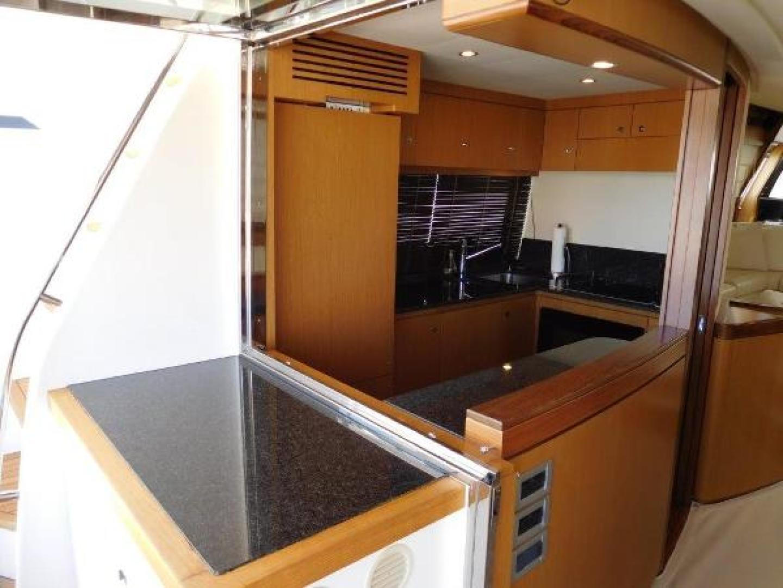 Ferretti Yachts-630 2009-BREAKAWAY Treasure Island-Florida-United States-Galley  Open to Aft Deck-1097536 | Thumbnail