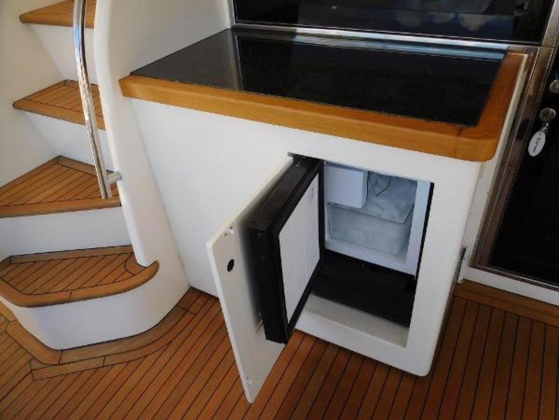 Ferretti Yachts-630 2009-BREAKAWAY Treasure Island-Florida-United States-Aft Deck Cabinet and Ice Maker-1097547 | Thumbnail