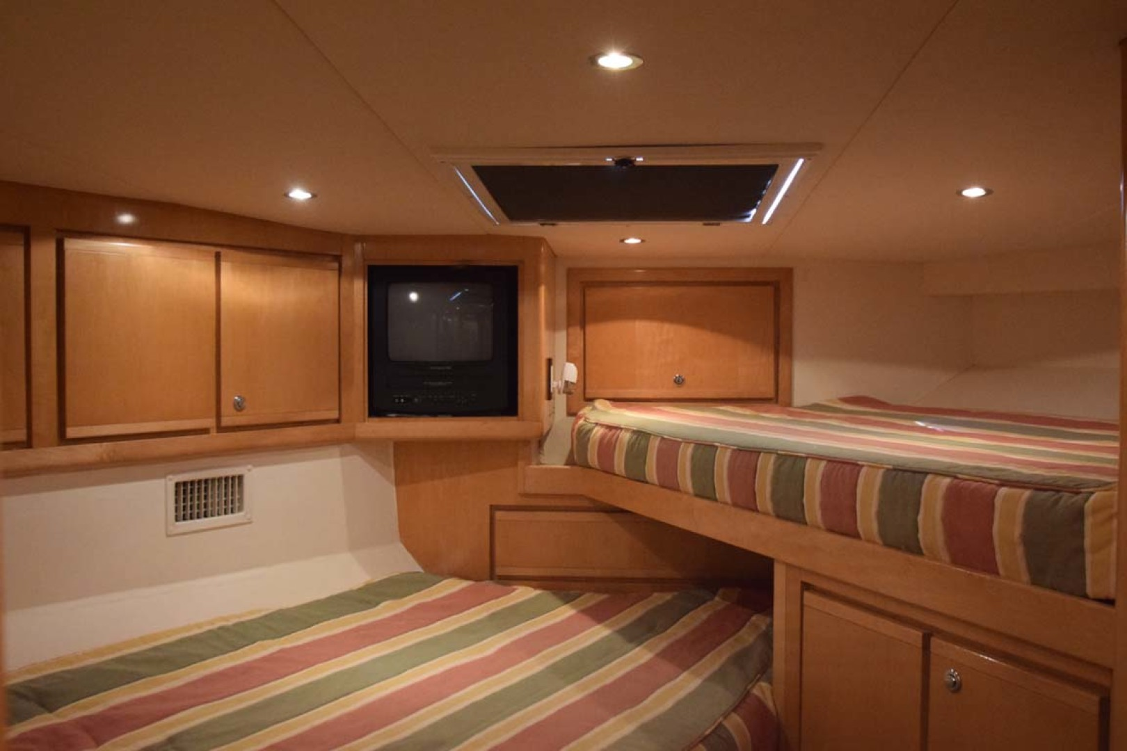Bertram-60 Convertible 1998-CHARDAN Lighthouse Point-Florida-United States-V-Berth Detail with TV and Storage Detail-1122722 | Thumbnail