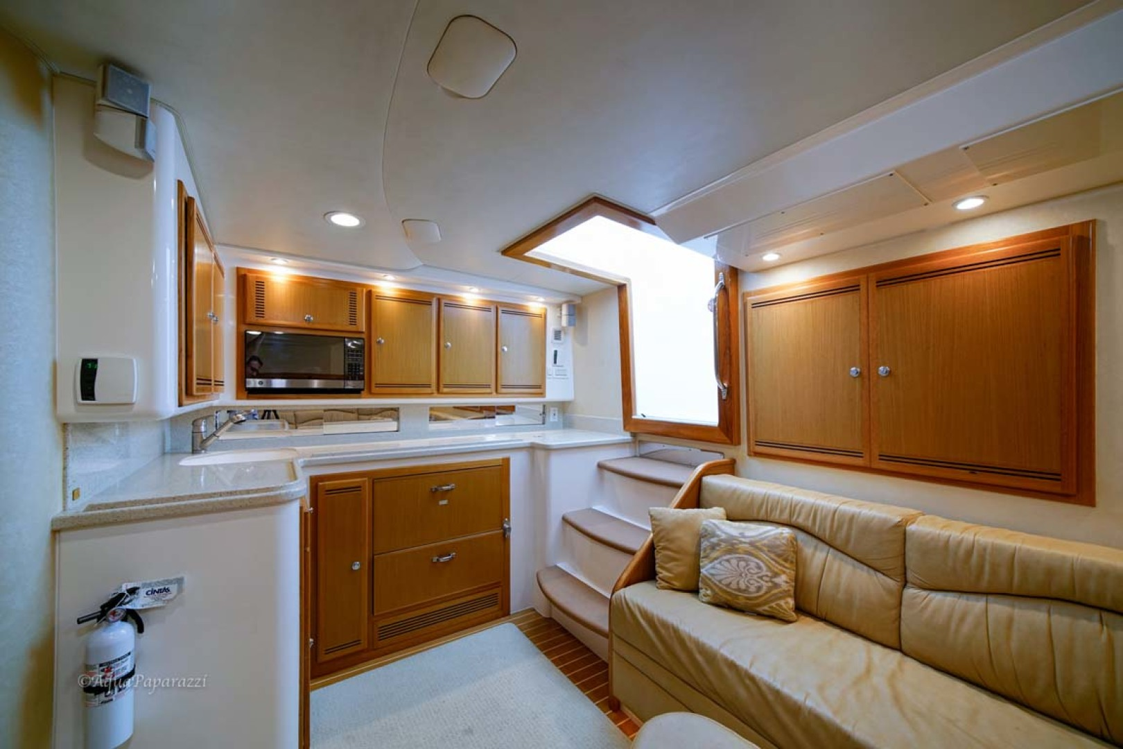 Cabo-Express 2007-Marauder Palm Beach Gardens-Florida-United States-Cabin Entry With Galley And Settee-1189475   Thumbnail