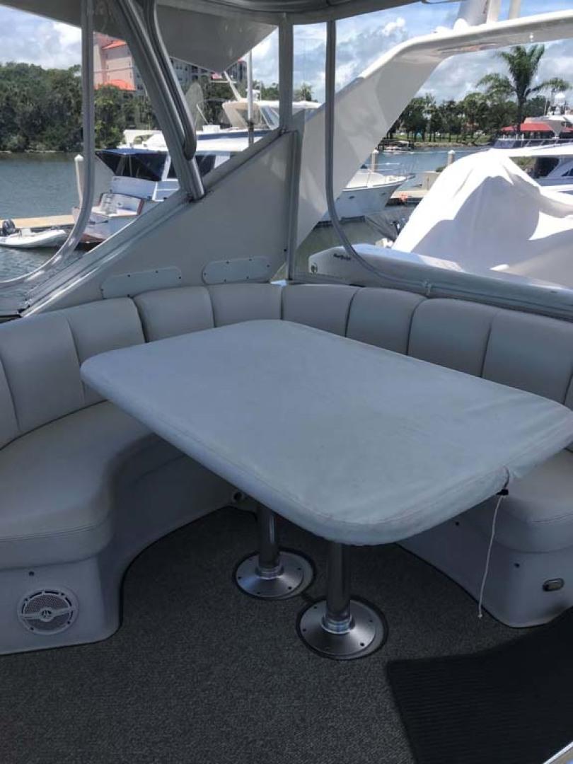 Marquis-Flybridge Motor Yacht 2004-Sandy Island Palm Coast-Florida-United States-Flybridge Table Covered-1202543 | Thumbnail