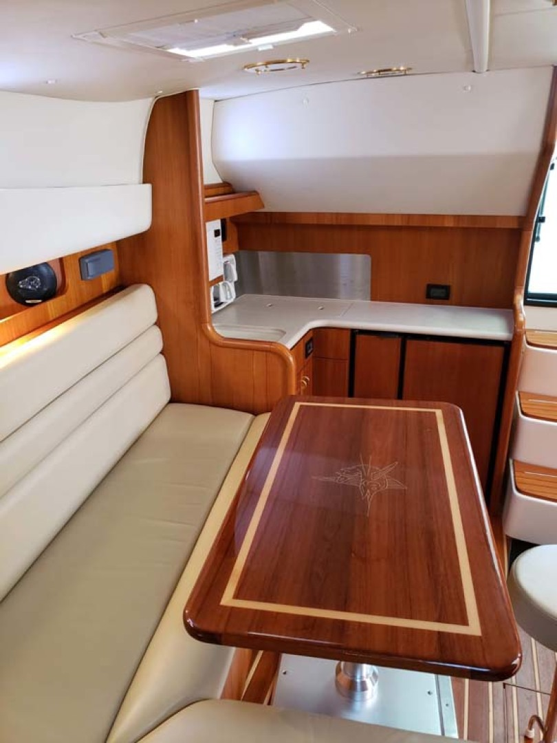 Pursuit-3800 Express 2004-CAN MAN Montauk-New York-United States-Galley and Dinette Table And Seating Converts To A Bed-1250924 | Thumbnail
