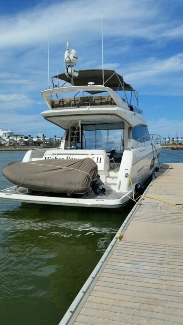 Prestige-550 2015-Higher Powered II Palm Coast-Florida-United States-Stern and Dinghy Covered-1300865 | Thumbnail
