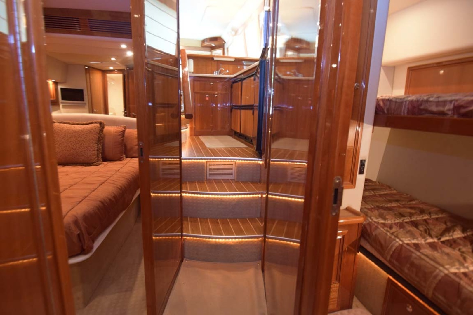Riviera-Enclosed Flybridge 2007-Magica II Coral Gables-Florida-United States-VIew To Galley With Main Stateroom And Twin Bunks-1443176 | Thumbnail