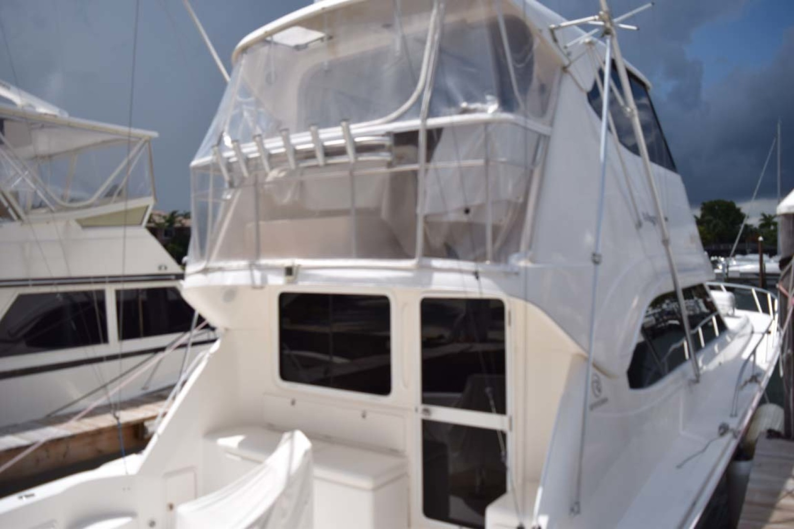 Riviera-Enclosed Flybridge 2007-Magica II Coral Gables-Florida-United States-Cockpit From Dock-1443186 | Thumbnail