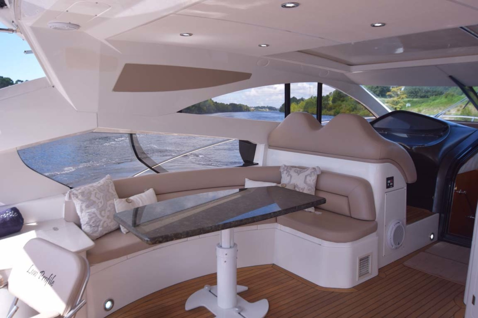 Sunseeker-Predator 2003-Low Profile PALM BEACH-Florida-United States-Midship Main Deck Table Flanked By Aft And Helm Companion Seating-1576376 | Thumbnail