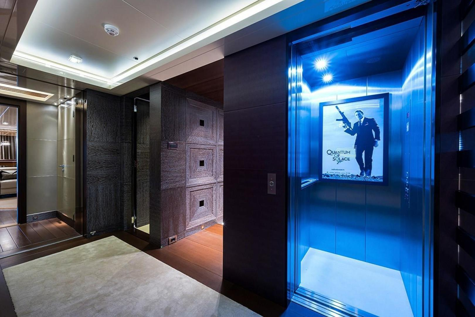 Turquoise 2012-QUANTUM OF SOLACE West Palm Beach-Florida-United States-Starboard Guest Entrance Foyer with 3-Story Elevator-1499661 | Thumbnail