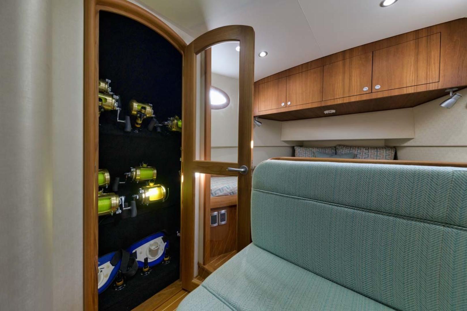 Winter Custom Yachts-46 Walkaround 2019-Family Circus Stuart-Florida-United States-Rod Storage Locker with Windowed Door-1563738 | Thumbnail