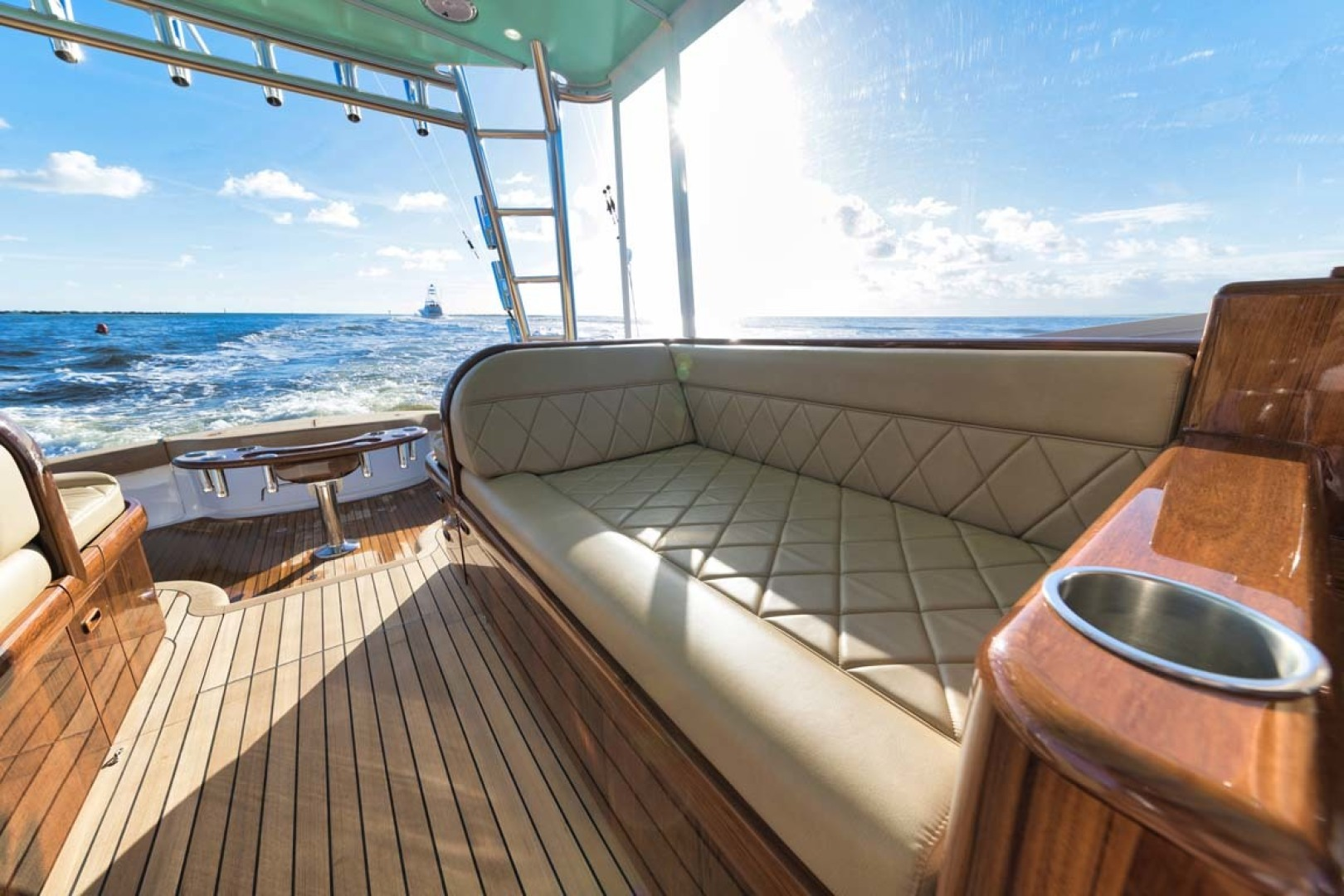 Winter Custom Yachts-46 Walkaround 2019-Family Circus Stuart-Florida-United States-Teak Port Seating with Diamond Stitched Ultra-Leather Upholstery and Storage Below-1563763 | Thumbnail