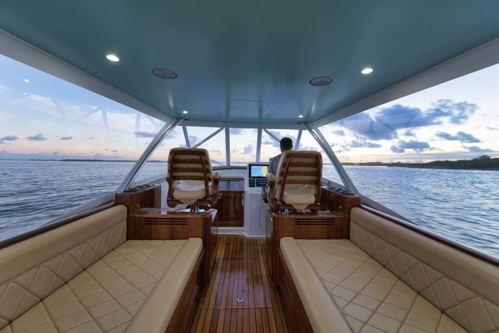 Winter Custom Yachts-46 Walkaround 2019-Family Circus Stuart-Florida-United States-Teak Mezzanine Seating with Diamond Stitched Ultra-Leather Upholstery and Storage Below-1563757 | Thumbnail