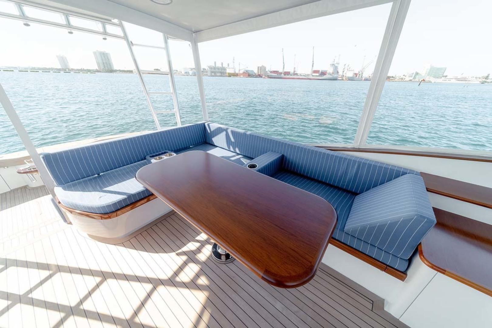 Jim Smith-Walkaround Express 2018-Eurybia North Palm Beach-Florida-United States-Teak Table and Storage underneath Seating-1573737   Thumbnail