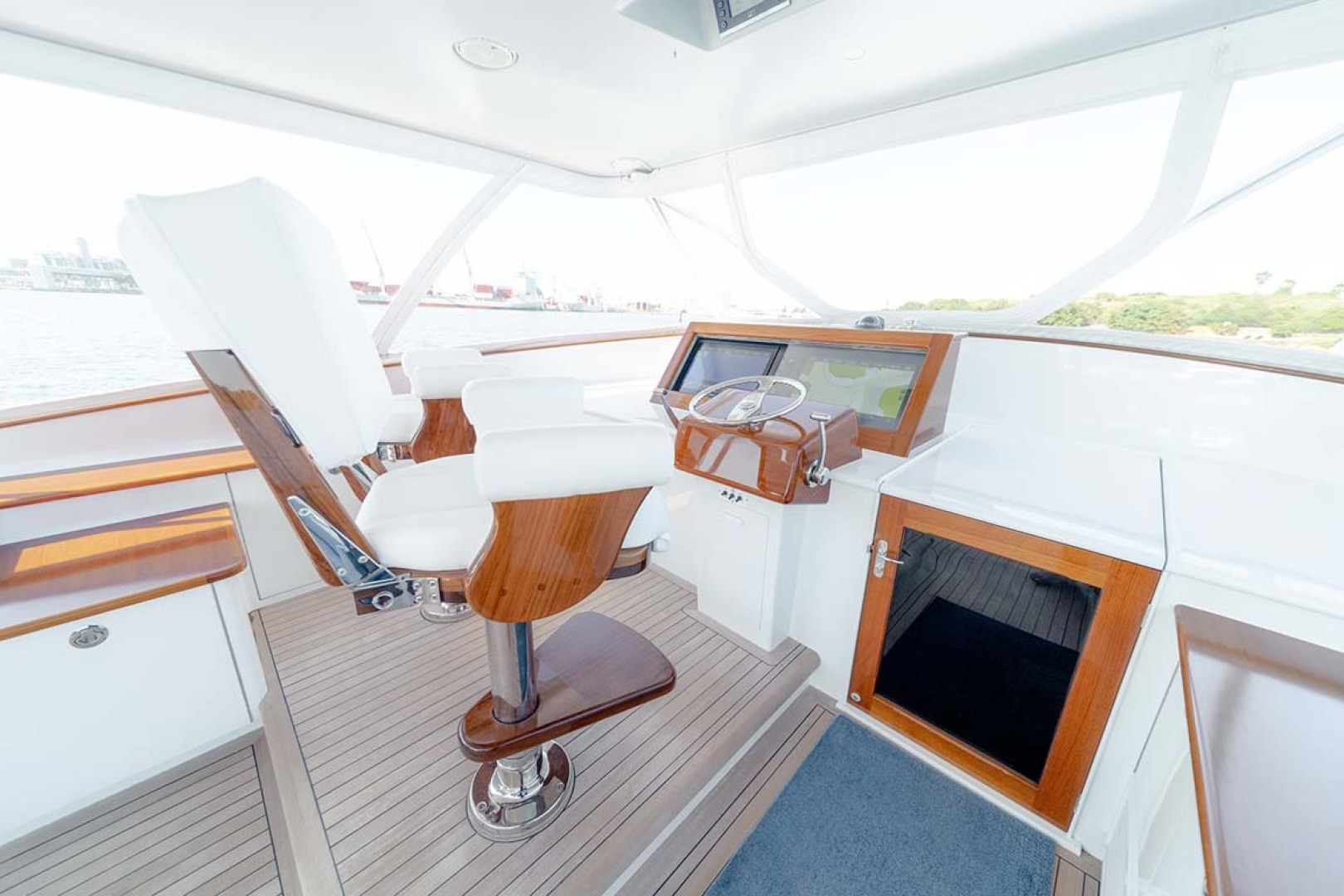Jim Smith-Walkaround Express 2018-Eurybia North Palm Beach-Florida-United States-2 x Bluewater Helm Chairs Mounted on Step up Teak Floor-1573731   Thumbnail