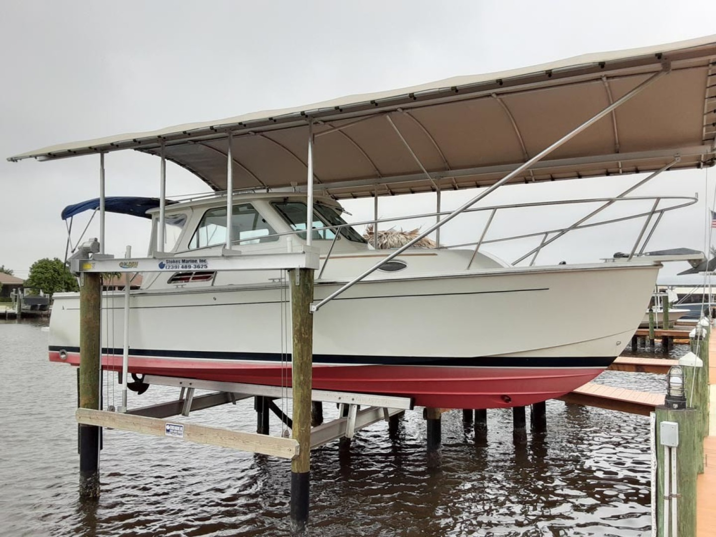 Back Cove-Express 2007-Patronus Cape Coral-Florida-United States Starboard Profile On Covered Lift-1596402 | Thumbnail