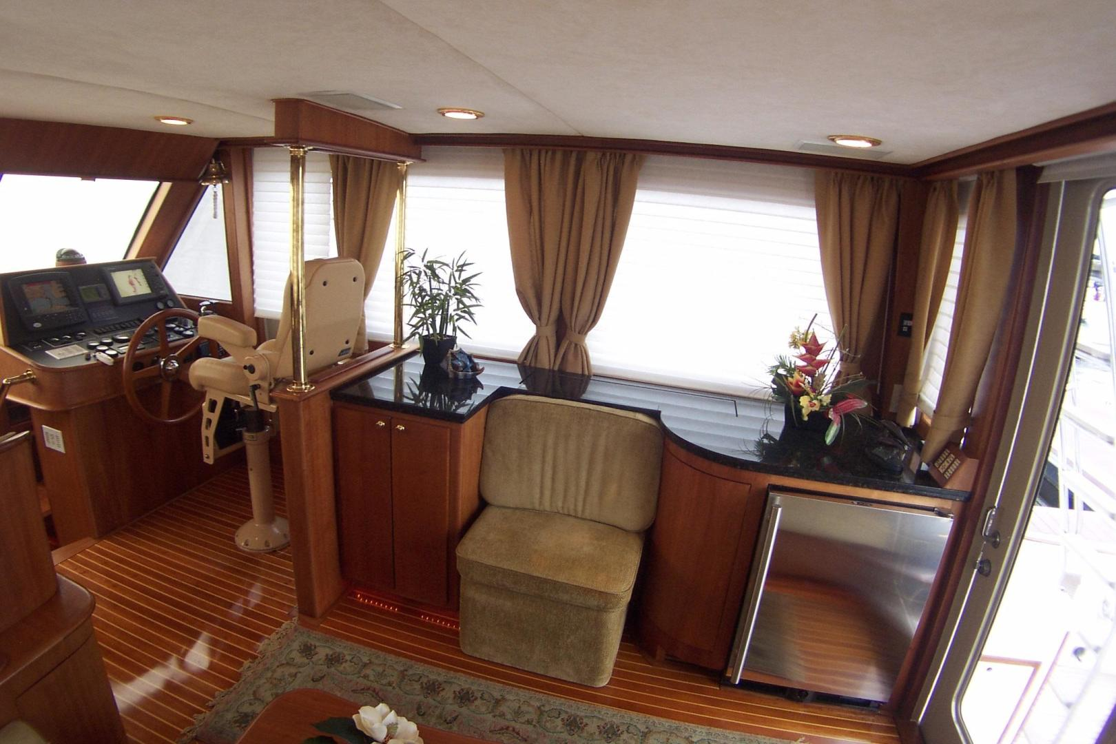 Legacy Yachts-Flybridge Sedan 2004-ARABELLA Stuart-Florida-United States-Salon to starboard; seat, bottle storage, concealed TV & Entertainment Center-453082 | Thumbnail
