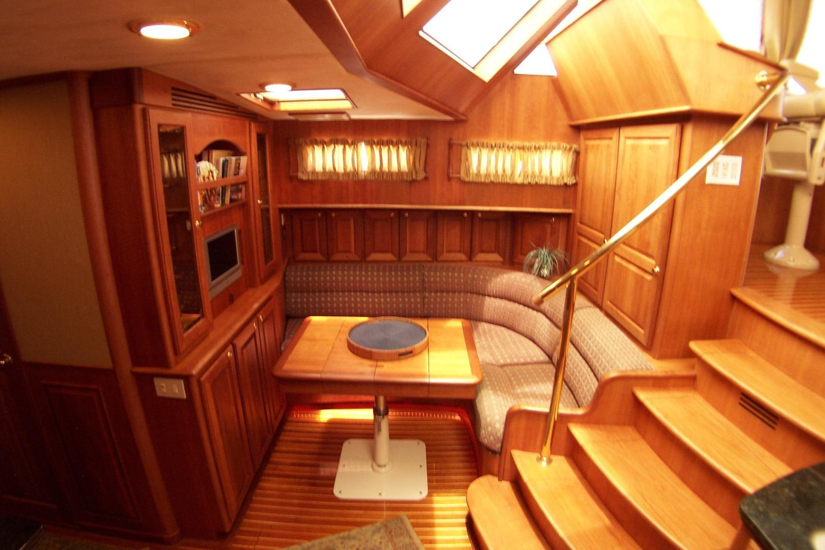 Legacy Yachts-Flybridge Sedan 2004-ARABELLA Stuart-Florida-United States-Dinette with Pedestal Table, Corner Settee, Glassware Cabinetry-453038 | Thumbnail