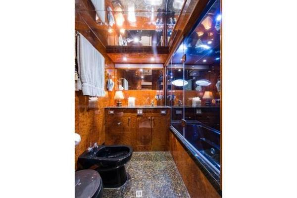 Mid stateroom head with jacuzzi tub aft
