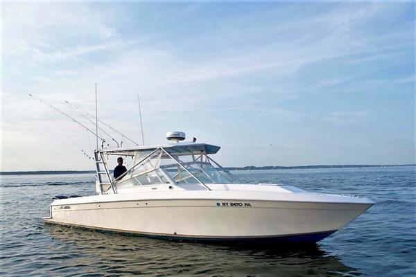 35' Contender 35 Side Console Express/REPOWERED 2003 | Wake Maker