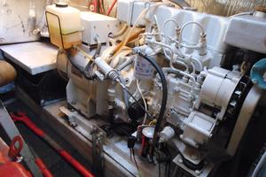 57' Wellington Pilothouse 1989 12KW Northern Lights generator to port