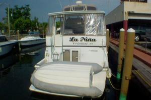 40' Carver 404 Cockpit Motor Yacht 1999 Stern view (dinghy not included)