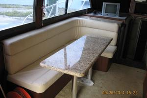 55' Hatteras Convertible 1985 Salon couch w/Table