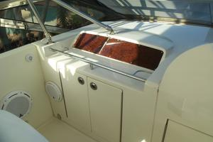 65' Marquis Flybridge 2006 HELM OUTBOARD TO PORT