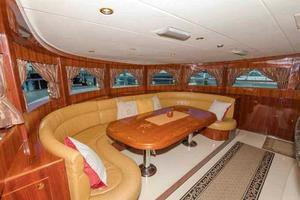 87' Johnson Flybridge w/Euro Transom 2005 Galley Dining to Starboard