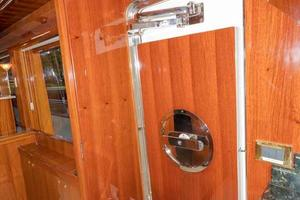 87' Johnson Flybridge w/Euro Transom 2005 Galley Entrance Door