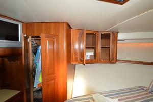 57' Viking Convertible 1990 Master Stateroom Port Hanging Locker / TV