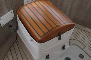 43' Hans Christian Traditional 1985 Varnished helm seat