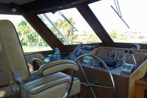 60' Hatteras Convertible/Enclosed FB 1979 Helm Chair