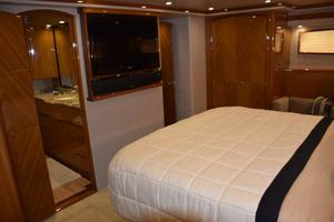 76' Viking 76 Enclosed 2010 Master Stateroom TV and Head entry