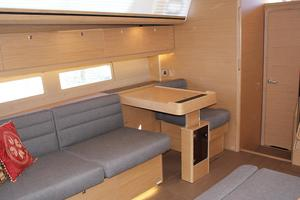 51' Dufour 51 2017 2017 Dufour 512GL - Starboard settee-convertible nav table