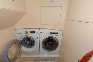 66' Neptunus Enclosed Skylounge 2005 Laundry Room